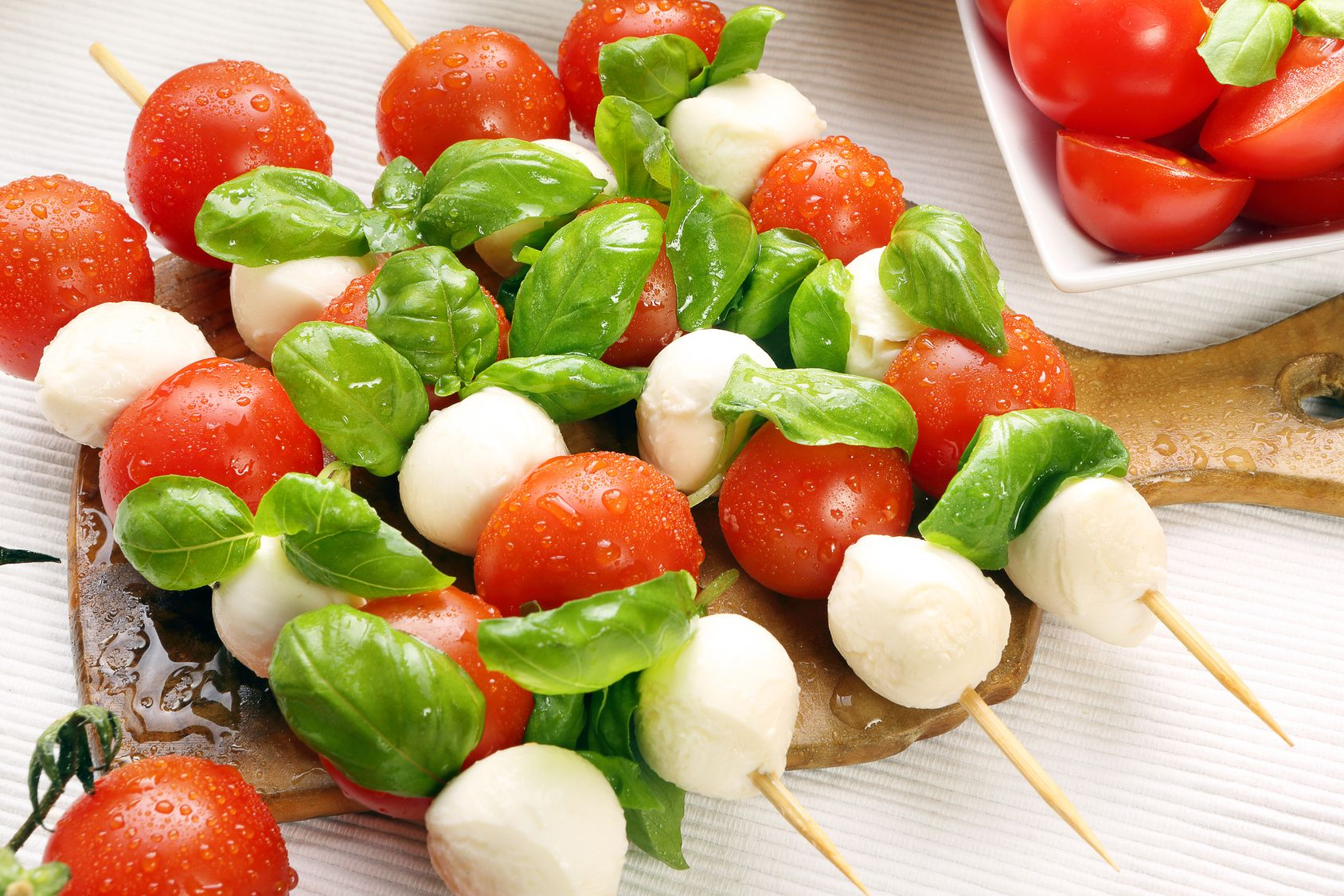 Caprese salad. Skewers with tomato and mozzarella with basil